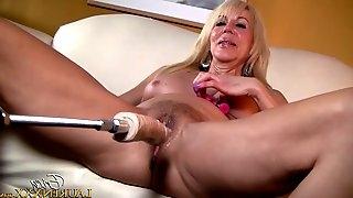 Nasty blonde Erica Lauren bends over for a fucking machine